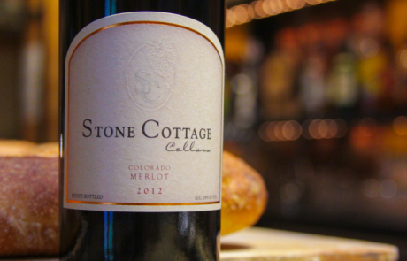 Stone Cottage Cellars 2012 Merlot wine bottle with bread in Town restaurant
