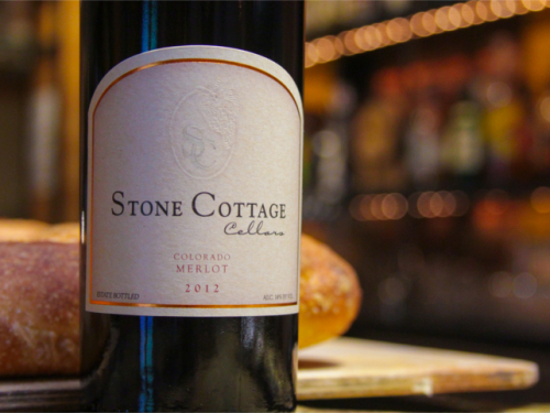 Stone Cottage Cellars 2012 Merlot wine bottle with bread in Town restaurant