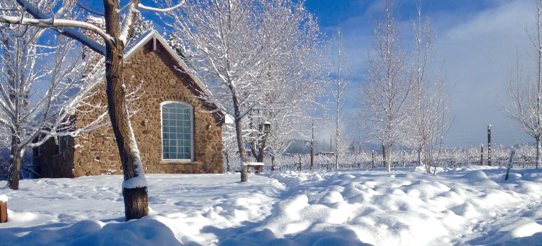 The Stone Cottage in the winter with snow at Stone Cottage Cellars in Paonia Colorado
