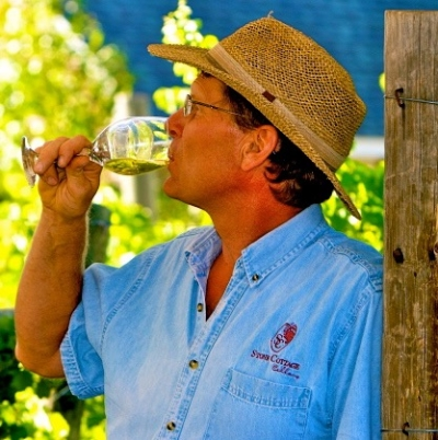 The winemaker, Brent Helleckson, drinking Colorado wine in the vineyard at Stone Cottage Cellars in Paonia, CO
