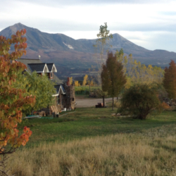 The Stone Cottage Cellars Tasting room in autumn by the mountains in Paonia Colorado